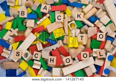 Scattered toy blocks on white background with inscription