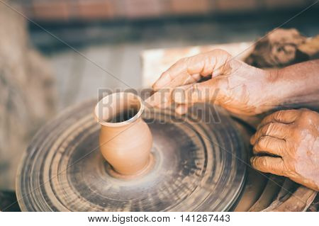 Master skulpting a clay pot, potter hands, crafting concept