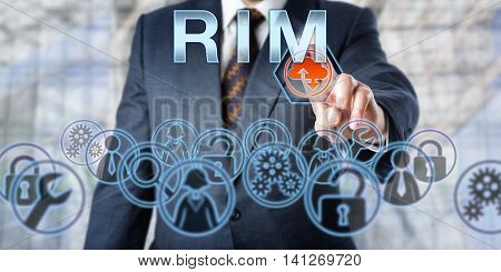 Business manager is pressing RIM onscreen. Computer networking and information technology metaphor. Business IT services concept and acronym for Remote Infrastructure Management.
