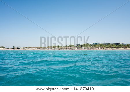 The Mediterranean sea view from the boat on the hotel beach with bungalows