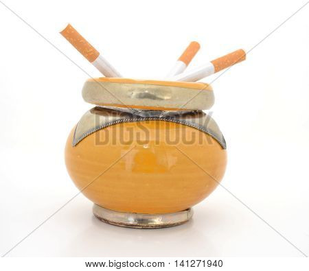 Ceramic ashtray yellow oriental style with blond cigarette