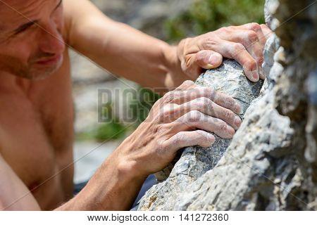 Man climbing on limestone. Muzzerone mountain, Liguria, Italy