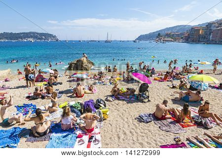 Crowded Summer Beach In Villefranche-sur-mer, Nice, France
