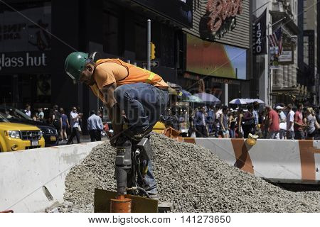 New York NY USA --Aug 3 2016-- A construction worker is hard at work at a construction site in Midtown Manhattan. Editorial Use Only.