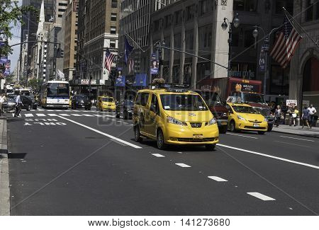 New York NY USA - Aug 3 2016 Traiffic is busy on Fifth Avenue as cabs cars and buses head South around lunchtime. Editorial Use Only.