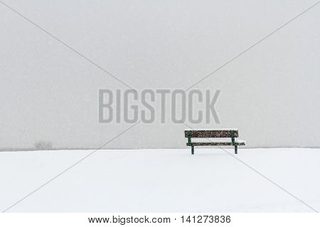 Bench in Winter snowing for background use