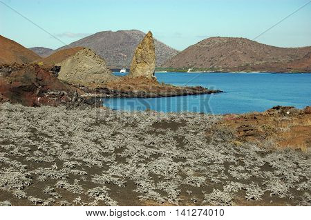 Arid landscape with Pinnacle rock in the distance,Sullivan Bay, Galapagos
