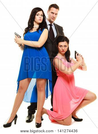 Man detective secret agent criminal and two sexy spies women with gun. Isolated on white background