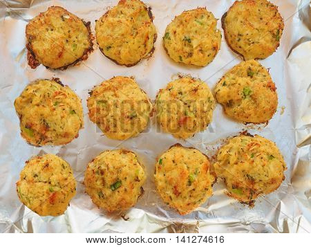 Homemade crab cakes baked on foil-covered tray