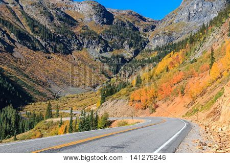 a scenic southwest colorado mountain highway in autumn