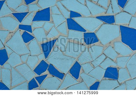 Blue tile mosaic texture. Vibrant mosaic of tiles as a background image. Blue mosaic background. Background of blue mosaic tiles in a pattern.