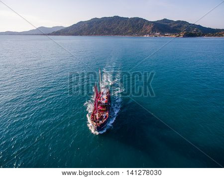 Aerial view red sailing ship is coming by the sea