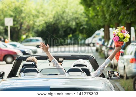 Newlyweds Young Couple Traveling In The Car