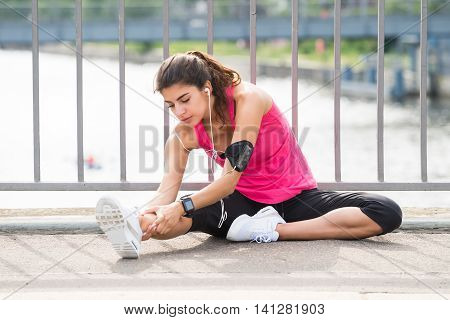 Young Woman Doing Listening To Music While Exercising