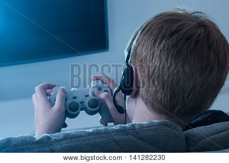 Close-up Of A Boy Holding Joystick Playing Videogame