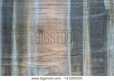 Stone Wall with Water Streaks of Grey, Salmon, and Black