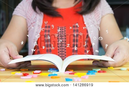 drawing English letters above open book represent learning English