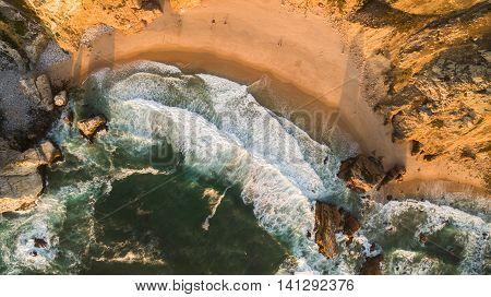Beautiful Ocean Beach at sunset Praia da Ursa aerial view