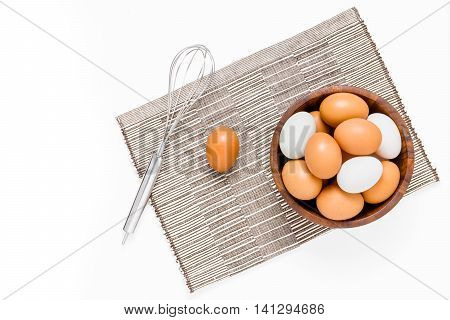 Top View Of Eggs In Bowl On White Backgrond.