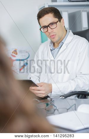 doctor and patient are discussing something