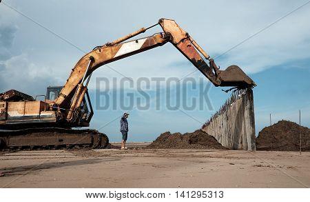 Excavator Build Breakwater At Beach