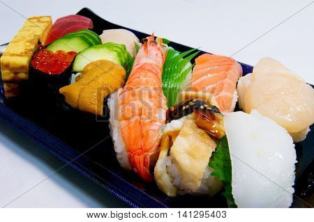 Salmon roe, sea urchin, raw shrimp Japanese nigiri sushi.