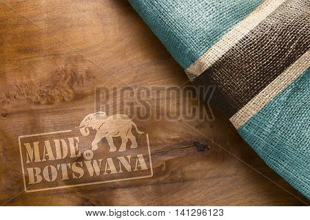 Stamp imprint on a wooden surface - Made in Botswana and the Botswana flag State.