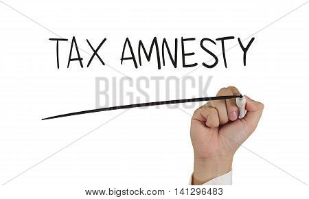 Business concept image of a hand holding marker and write Tax Amnesty words isolated on white