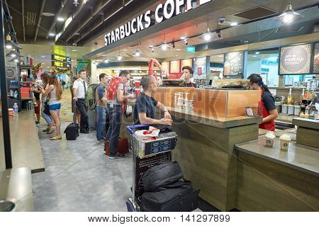 SINGAPORE - CIRCA NOVEMBER, 2015: Starbucks at Singapore Changi Airport. Starbucks Corporation is an American global coffee company and coffeehouse chain.