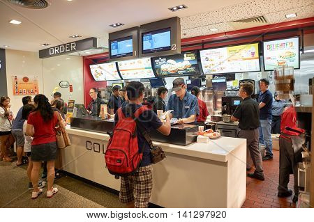 SINGAPORE - CIRCA NOVEMBER, 2015: McDonald's in Singapore Changi Airport. McDonald's is the world's largest chain of hamburger fast food restaurants.