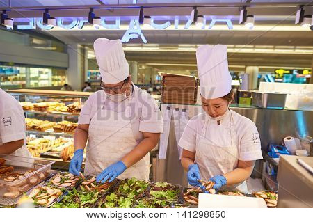 SINGAPORE - CIRCA NOVEMBER, 2015: workers in a cafe at Singapore Changi Airport. Changi Airport  is the primary civilian airport for Singapore.
