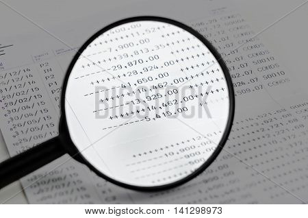 Magnifier and book bank on white background.