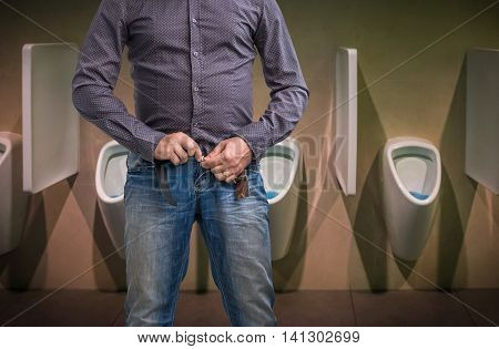 Man Zip His Pants Up After Peeing On The Public Toilet