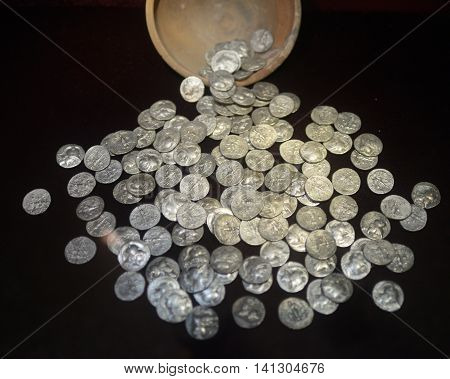 image of silver coins on a black background