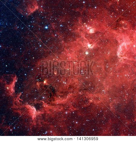 The North America nebula is an emission nebula in the constellation Cygnus close to Deneb. Infrared view from NASA's Spitzer Space Telescope. Retouched image. Elements of this image furnished by NASA