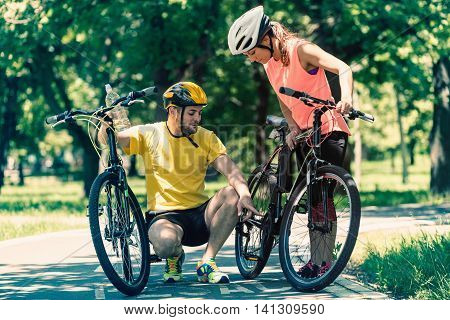 Young couple with bicycles. Toned image, toned image