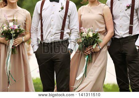 Stylish groomsmen with bridesmaids