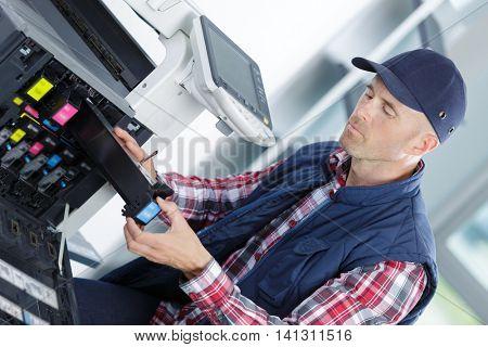repairing a printer at work