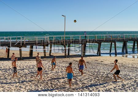Adelaide Australia - February 7 2016: People playing volleyball at Henley Beach on a warm sunny day.