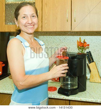 Woman Making Coffee Using Espresso Machine