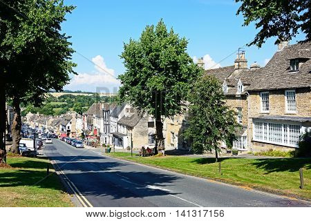 BURFORD, UNITED KINGDOM - JULY 20, 2016 - View along The Hill shopping street during the Summertime Burford Cotswolds Oxfordshire England UK Western Europe, July 20, 2016.