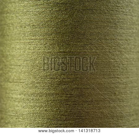 Closeup green thread textile texture for background.