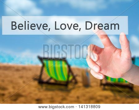 Believe, Love, Dream - Hand Pressing A Button On Blurred Background Concept On Visual Screen.