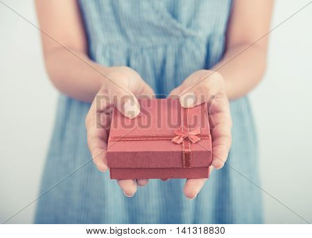 Woman hands holding gift box give for christmas or new year congratulation.