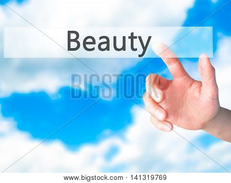 Beauty - Hand Pressing A Button On Blurred Background Concept On Visual Screen.