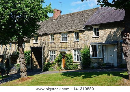 BURFORD, UNITED KINGDOM - JULY 20, 2016 - Cotswold cottages at the top end of The Hill shopping street Burford Oxfordshire England UK Western Europe, July 20, 2016.