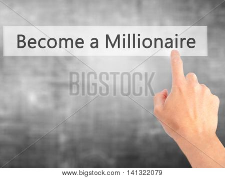 Become A Millionaire - Hand Pressing A Button On Blurred Background Concept On Visual Screen.
