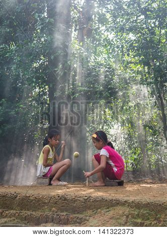HANOI, VIETNAM, JULY 24, 2016: Countryside children play traditional game in a village in Hanoi, Vietnam.
