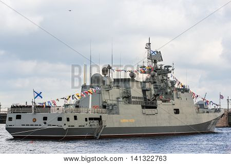 St. Petersburg, Russia - 31 July, Flagship military ship at anchorage, 31 July, 2016. Festive parade of warships on the Neva River in St. Petersburg.