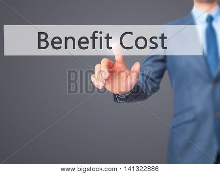 Benefit Cost - Businessman Hand Pushing Button On Touch Screen